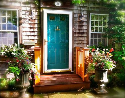 A welcoming front door on this Nantucket vacation rental