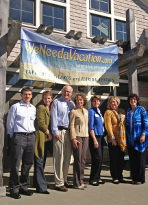 Joan and Jeff Talmadge with some of the staff of WeNeedaVacation.com