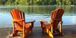 Two Empty Adirondack chairs on deck