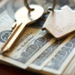 Security deposits - money with a key on a house ring